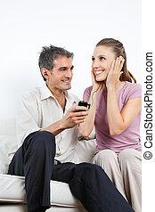 Couple Listening Music On Cell Phone