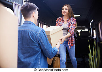 Couple Loading Moving Van
