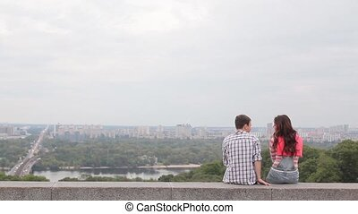 Couple look at the panorama of the city
