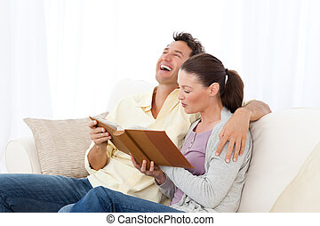 Couple looking a photo album