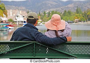 Couple Looking at a Lake