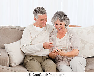 Couple looking at a photo  at home