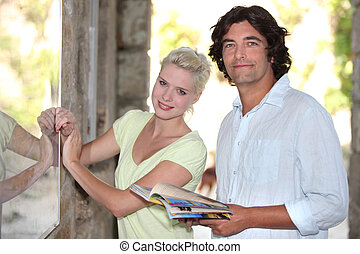 Couple looking at a tourist board