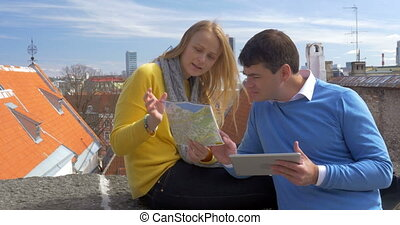 Couple looking at city map outdoor