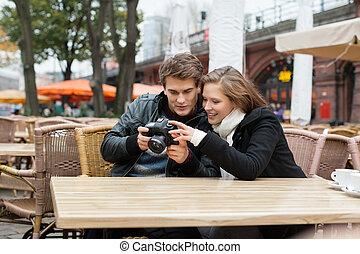Couple Looking At Digital Camera