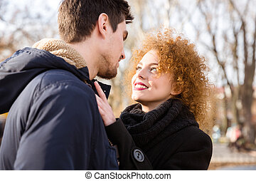 Couple looking at each other outdoors