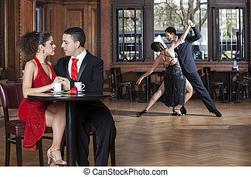 Couple Looking At Each Other While Tango Partners Performing...