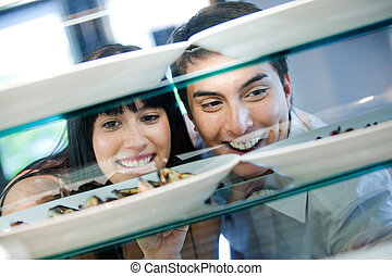Couple Looking at Food
