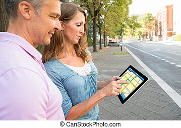 Couple Looking At Gps Map