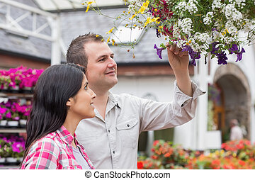 Couple looking at hanging basket