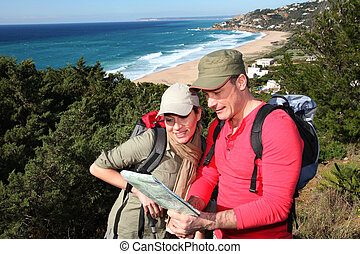 Couple looking at map on a hiking day