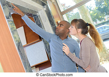Couple looking at marble tiles