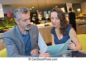 Couple looking at menu in restaurant