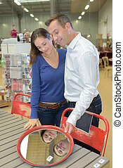 Couple looking at mirror in a store