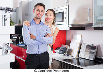 Couple looking at modern kitchen