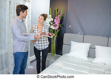 Couple looking at new bed