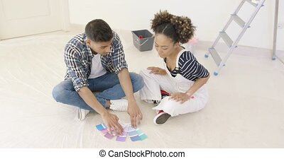 Couple looking at paint swatches for decorating