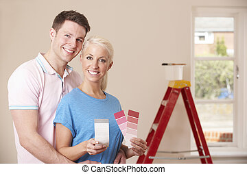Couple Looking At Paint Swatches Together