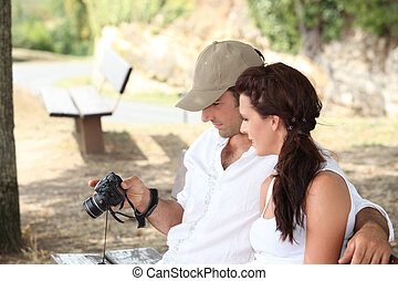 Couple looking at photos on camera