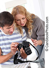 Couple looking at picture on camera screen