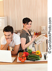 Couple looking at recipes