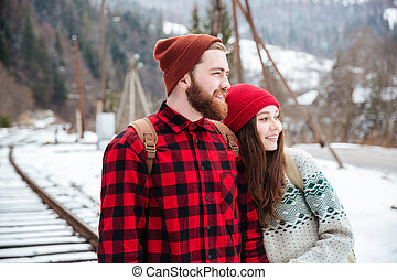 Couple looking at something outdoors