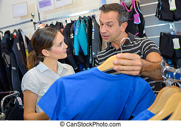Couple looking at sportswear
