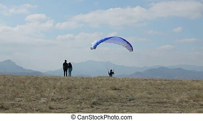 couple looking at the glider