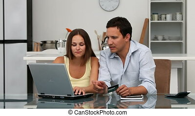 Couple looking at their accounts