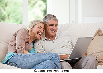 Couple looking at their laptop
