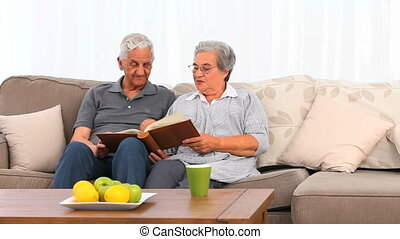 Couple looking at their photo album