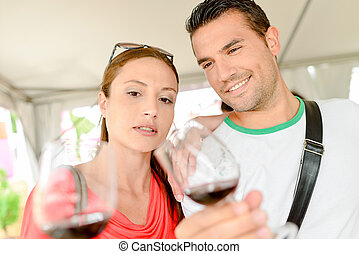 Couple looking at their wineglasses