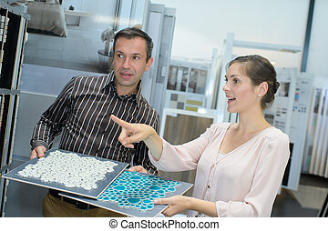 Couple looking at tile samples