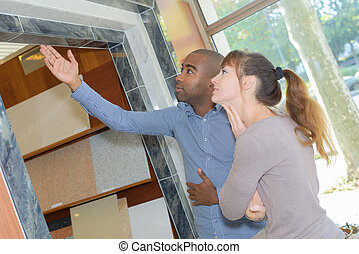 Couple looking at wall tiles