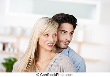 Couple Looking Away In Kitchen