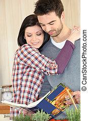 Couple looking cookbook