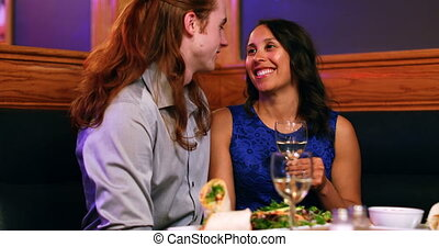 Couple looking each other while talking in night club 4k