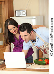 Couple looking for a recipe on the internet