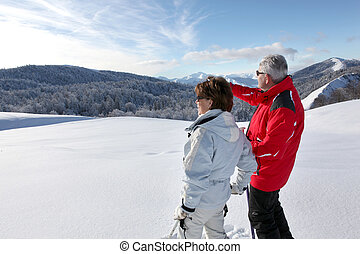Couple looking landscape in the snow