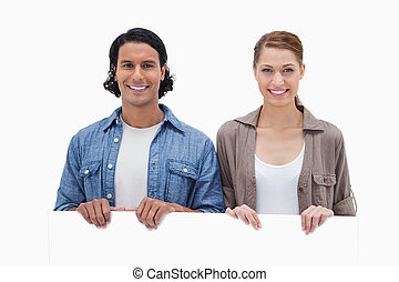 Couple looking over blank wall