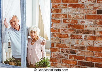 Couple looking through window