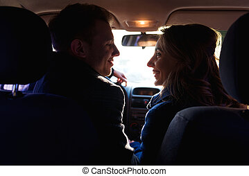 Couple looking to each other in the car