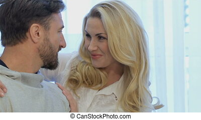 Couple looks at each other at home