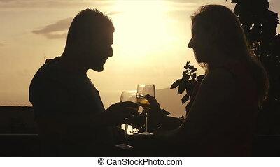 couple love flirting drinking wine