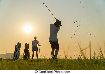 Couple lover in action of playing golf together. Golf ball away from the rough to fairway, Difficult time stay together in the family course. Beautiful nature silhouette.