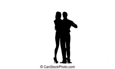 one couple lovers man and woman dancing tango in studio silhouette isolated on white background. Silhouette. Slow motion