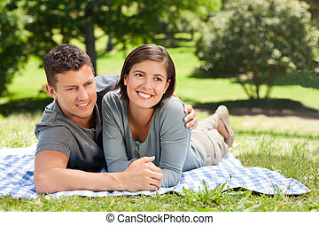 Couple lying down in the park