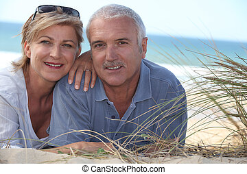 Couple lying in the dunes