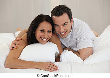 Couple lying on a bed