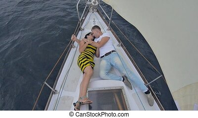 couple lying on a yacht